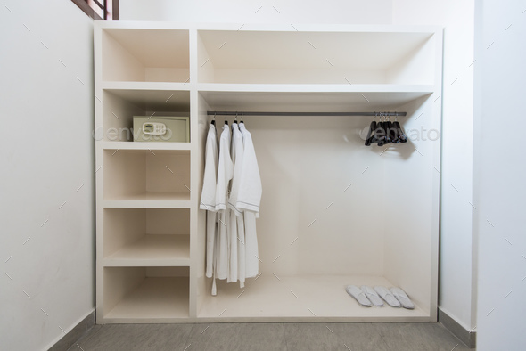 Bathrope, safe box and cloth hanger in wardrope - Stock Photo - Images