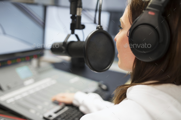 Jockey Wearing Headphones While Using Microphone In Radio Studio - Stock Photo - Images