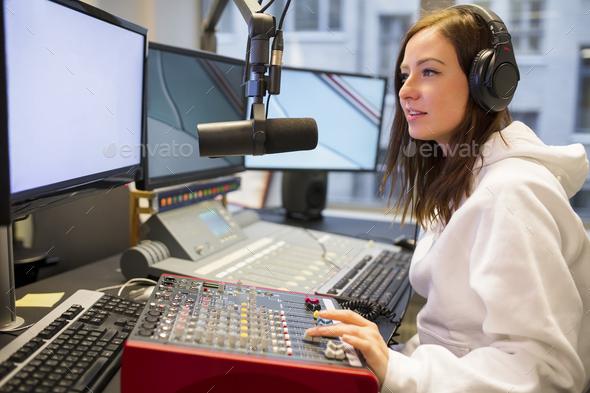 Female Host Using Control Panel At Radio Station - Stock Photo - Images