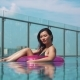 Pretty Girl with Buoy in Swimming Pool