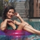 Pretty Girl Posing in a Ring Buoy in Swimming Pool
