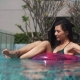 Pretty Girl Floating in Ring Buoy in Swimming Pool