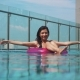 Pretty Girl Playing in Ring Buoy in Swimming Pool