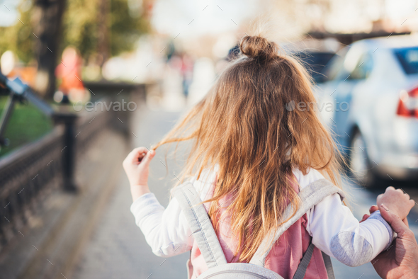 Little girl on the street - Stock Photo - Images