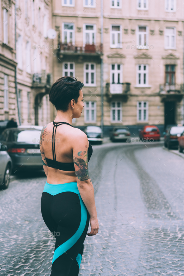 Woman doing exercise in the city street - Stock Photo - Images