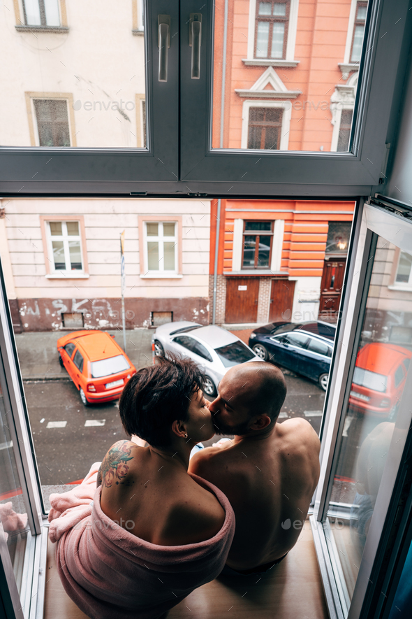 Man and beautiful girl while sitting by the window - Stock Photo - Images