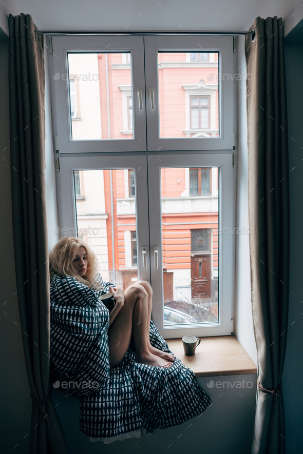 girl sitting on a window - Stock Photo - Images