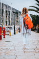 Young woman with orange backpack - PhotoDune Item for Sale