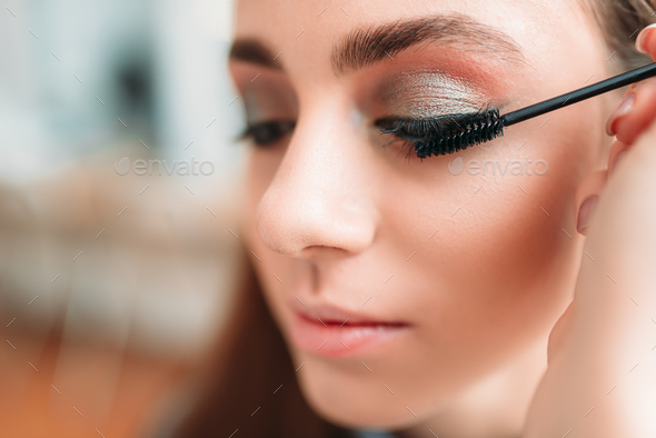Make up artist work with woman eyes - Stock Photo - Images