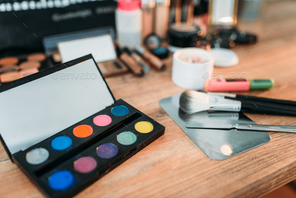 Cosmetics tools on wooden table, closeup - Stock Photo - Images