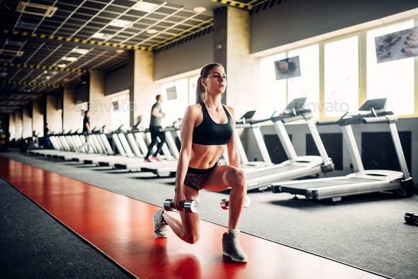 Slim woman doing exercise with dumbbells - Stock Photo - Images