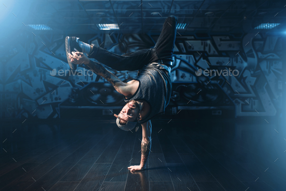 Breakdance action, dancer posing in dance studio - Stock Photo - Images