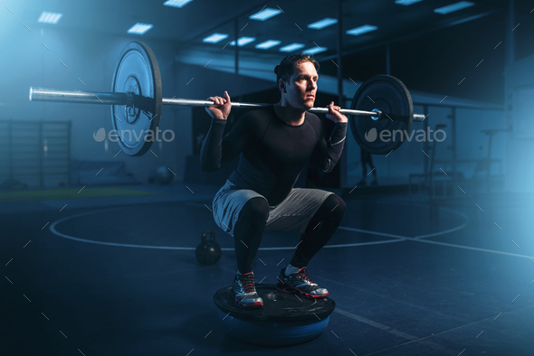 Strength athlete on training, workout with barbell - Stock Photo - Images