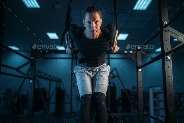 Athlete on training, exercise on gimnastic rings - Stock Photo - Images