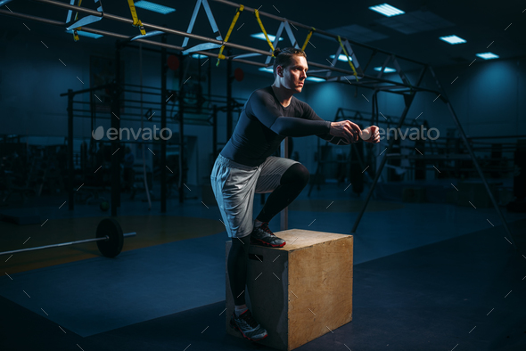 Athlete on training, endurance exercise with box - Stock Photo - Images