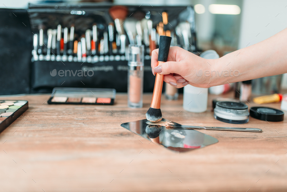 Make up artist hand with brush prepares cosmetics - Stock Photo - Images