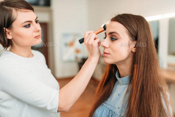 Professional beautician work with woman eyebrows - Stock Photo - Images