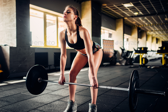 Female athlete training with barbell in sport gym - Stock Photo - Images