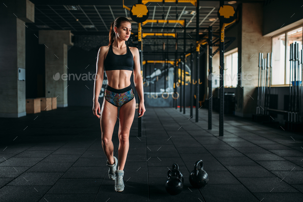 Female athlete with muscular body posing in gym - Stock Photo - Images