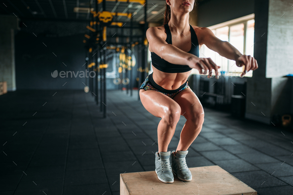 Woman doing box jump exercise in fitness club - Stock Photo - Images