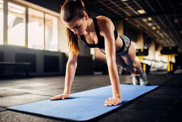 Female athlete doing push-up exercises in gym - Stock Photo - Images