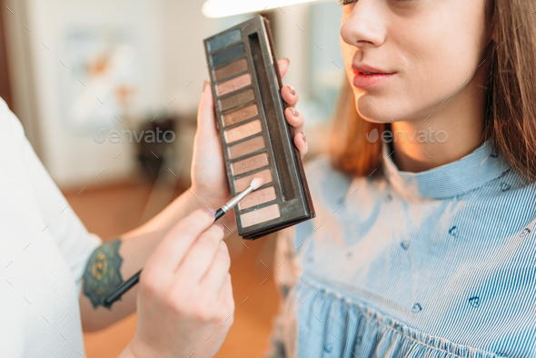Professional beautician work with woman face - Stock Photo - Images