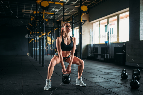 Woman doing exercise with weight in fitness club - Stock Photo - Images