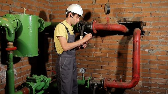 VideoHive The Worker Records the Readings of the Manometer on the Clipboard 20088779