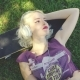 Young Blond Woman Relaxing Listening To Music
