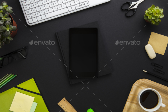Digital Tablet Surrounded By Office Supplies On Gray Desk - Stock Photo - Images