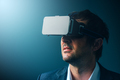 Businessman with VR goggles headset enjoying virtual reality