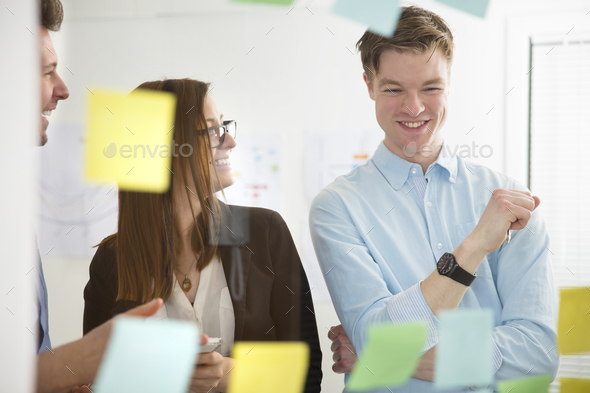 Business People Smiling In Office Seen Through Glass - Stock Photo - Images