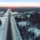 Intercity Highway Among Woodland at Sunset in Winter - VideoHive Item for Sale