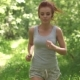 Red-Haired Woman on a Run. The Girl Watches Her Figure and Health