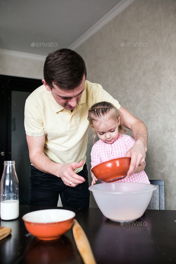 Dad and daughter together in the kitchen - Stock Photo - Images