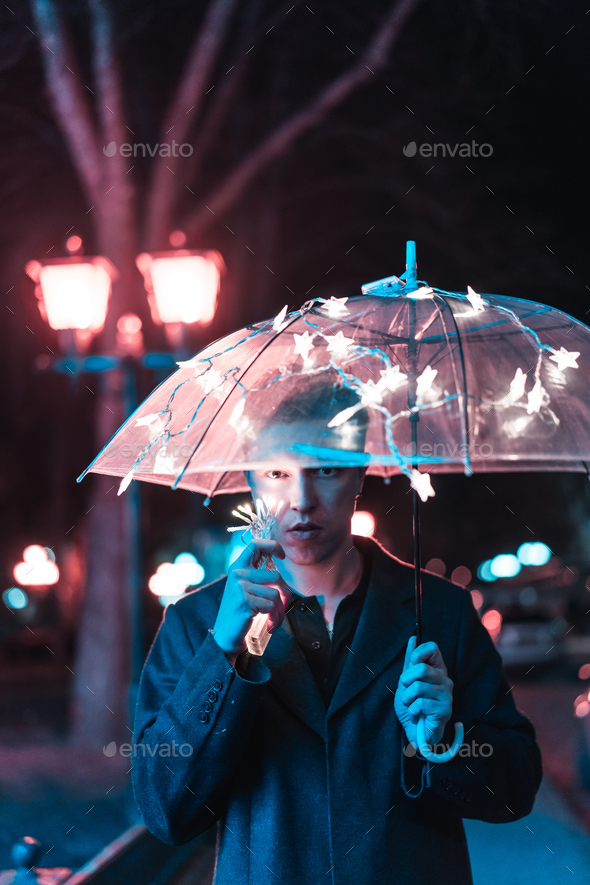 Guy under an umbrella - Stock Photo - Images