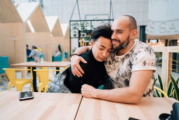 A man and a woman are sitting in a cafe - Stock Photo - Images