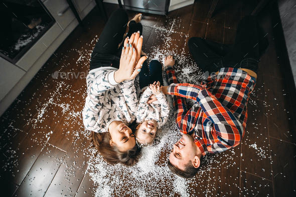 Happy family playing together on the floor - Stock Photo - Images