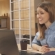 Woman Has a Video Chat at the Working Hub