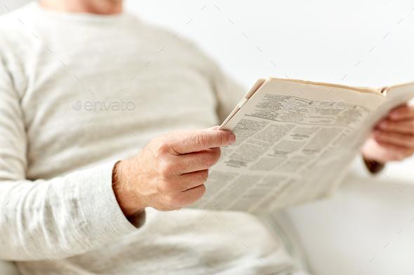 close up of senior man reading newspaper - Stock Photo - Images