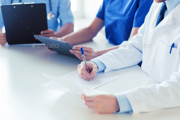 close up of happy doctors at seminar or hospital - Stock Photo - Images