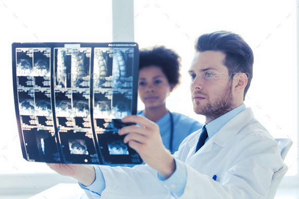 doctor and nurse looking to  x-ray at hospital - Stock Photo - Images