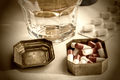 Metallic pillbox with white pills along with water glass - PhotoDune Item for Sale