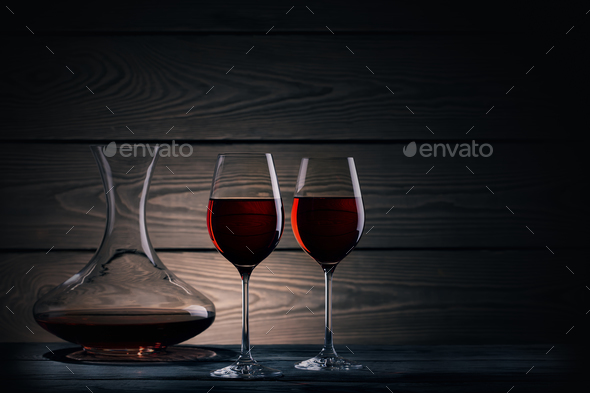 Two glasses and decanter of red wine on dark background - Stock Photo - Images