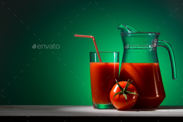 Tomato juice in a glass and jug - Stock Photo - Images