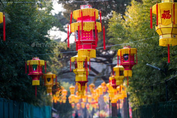 Yellow chinese lantern with messages wishing good luck, health, peace and prosperity - Stock Photo - Images