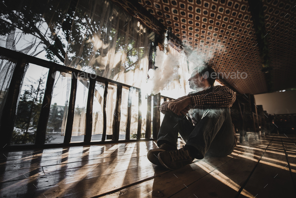 Young Man Using Vapourizer As Smoking Alternative - Stock Photo - Images