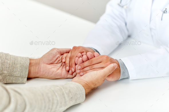 close up of doctor holding old man hand - Stock Photo - Images