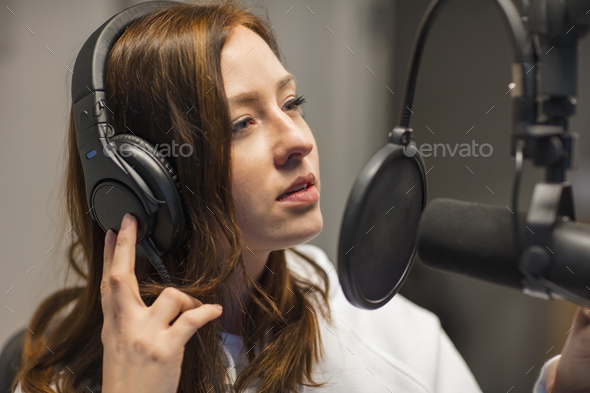 Jockey Listening Through Headphones In Radio Studio - Stock Photo - Images