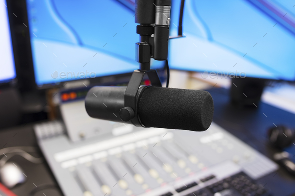Microphone in modern radio station broadcasting studio - Stock Photo - Images